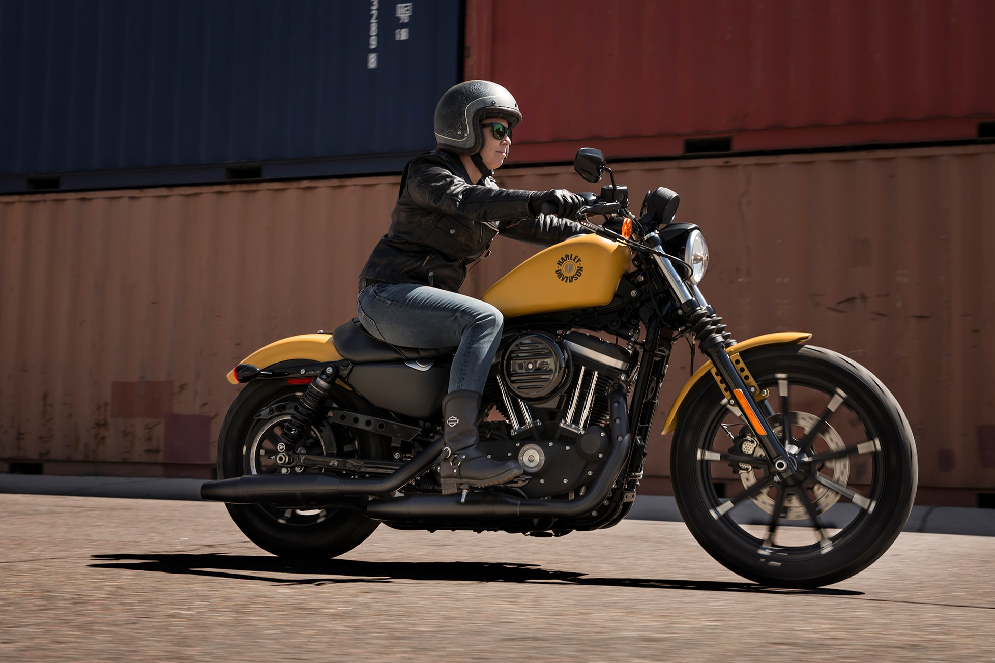 hight resolution of woman riding a 2019 iron 883 motorcycle