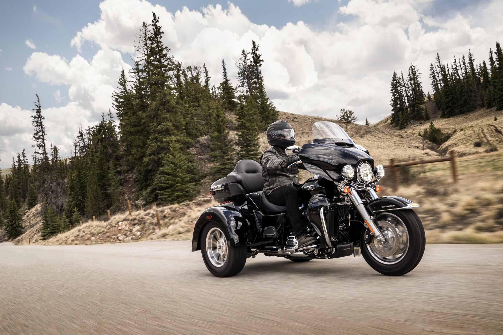 hight resolution of man riding 2019 tri glide ultra motorcycle