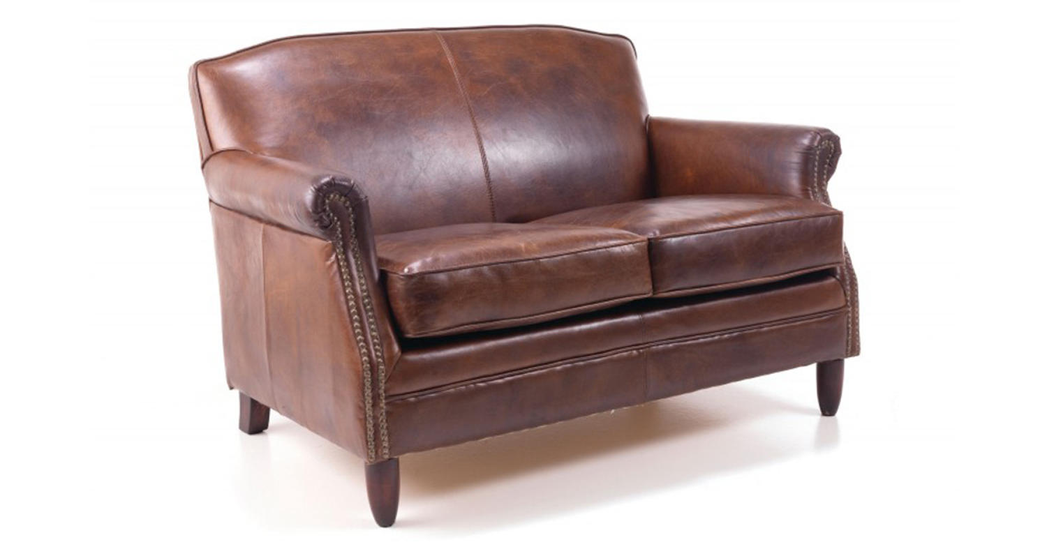 brown leather studded sofa with lights front in dorking surrey