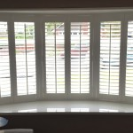 Faux Wood Shutters In A Bay Window Harmony Blinds Bolton