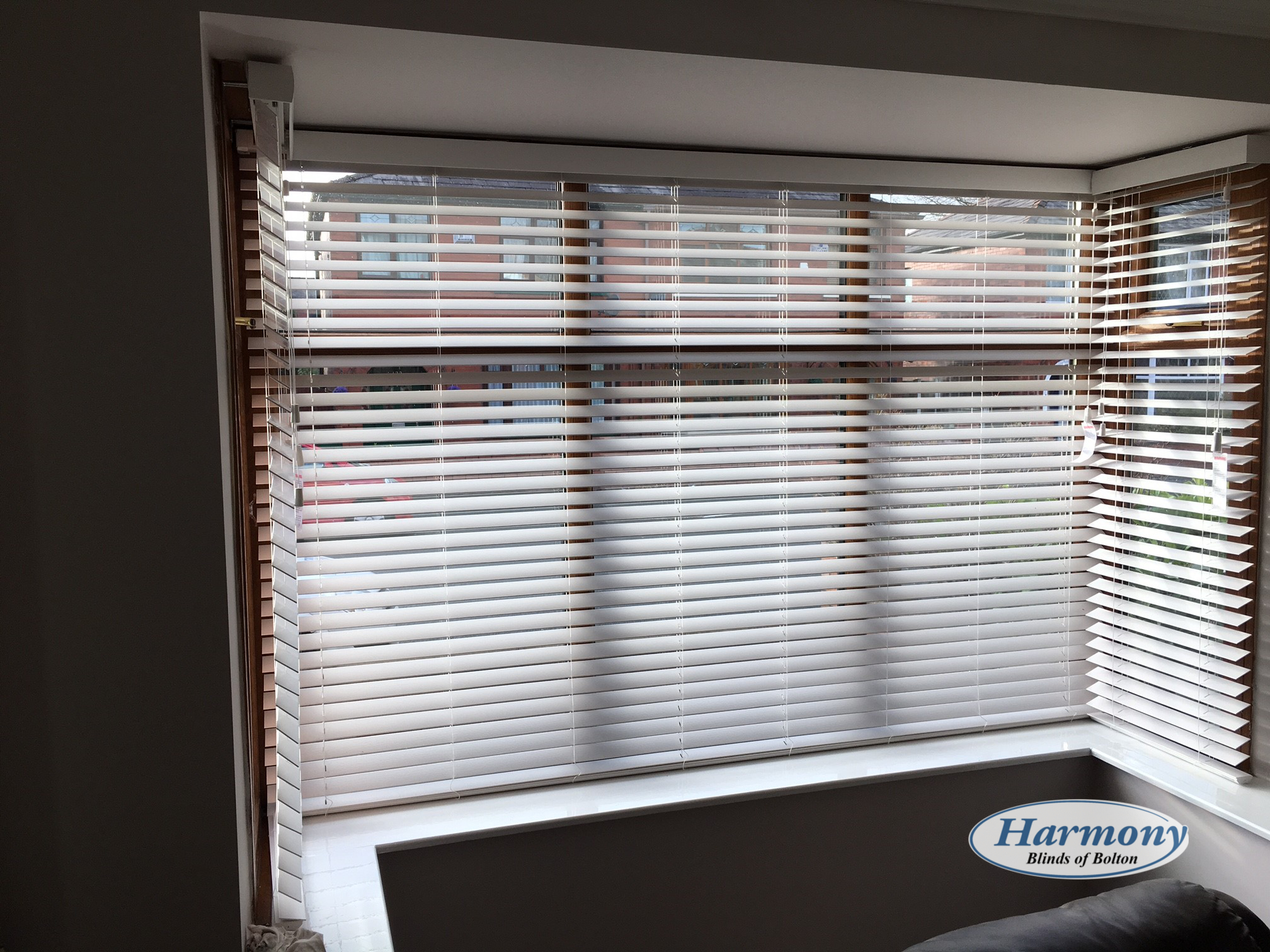White Faux Wood Blinds in a Bay Window