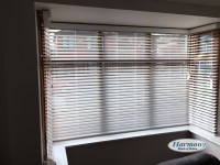White Faux Wood Blinds in a Bay Window - Harmony Blinds ...
