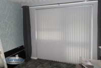 Wide Vertical Blind in White fabric covering Patio Doors ...
