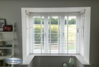 White Wooden Blinds with Tapes in a box Bay Window ...