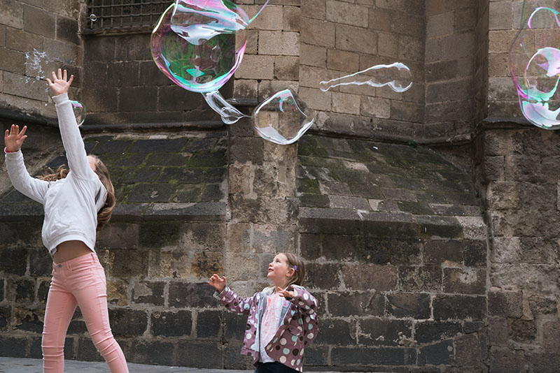 Kids Playing in the Bubbles