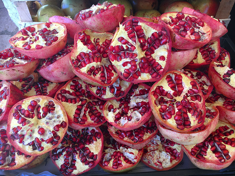 Piles of locally grown pomegranates