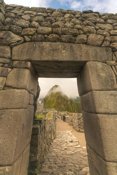 A Machu Picchu gate framing the citadel.