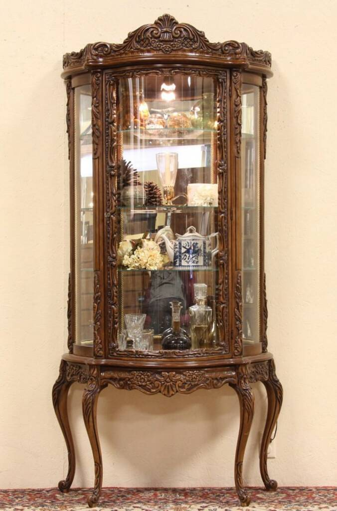 SOLD  Carved Fruitwood Curved Glass Curio Display Cabinet