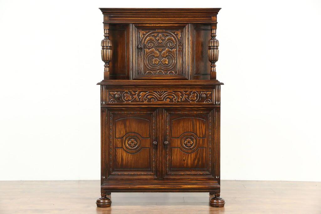 SOLD  English Tudor Style 1920 Antique Carved Oak Bar or