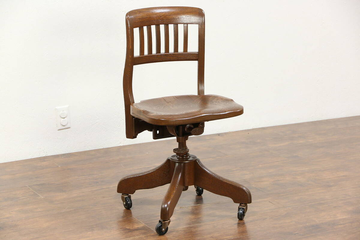 swivel chair quotes light blue velvet oak 1925 antique adjustable desk signed