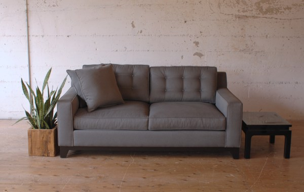 grey loveseat sofa and and black side table
