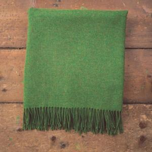 green blanket with tassels