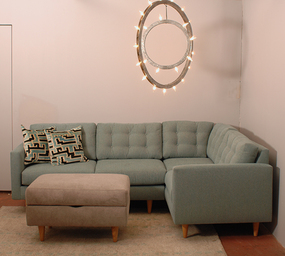 decorative light fixture hanging above a sofa and ottoman