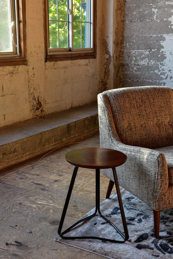Grey arm chair in living room with decor
