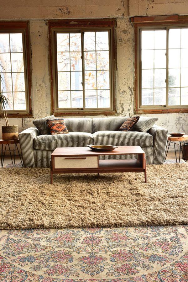 Grey velvet sofa and decor