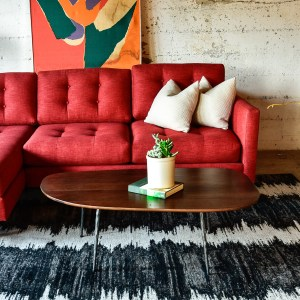Red sofa in living room with decor