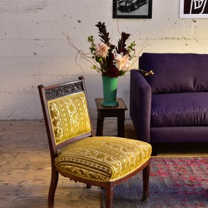yellow vintage chair in living room with decor