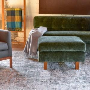 green velvet ottoman in living room