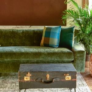 Green velvet sofa and decor in living room