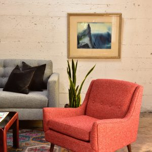 Red armchair in living room with decor