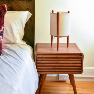 Mid century style bedside table with decor
