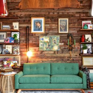 Green sofa in living room with decor