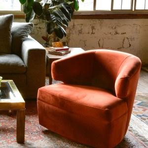 Mid century modern swivel chair in living room
