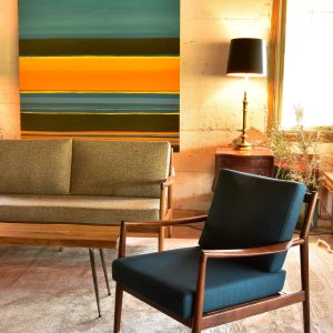 large colorful painting in a living room