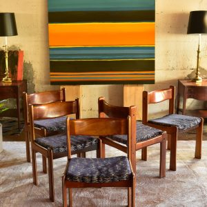 set of vintage wood dining chairs in a living room