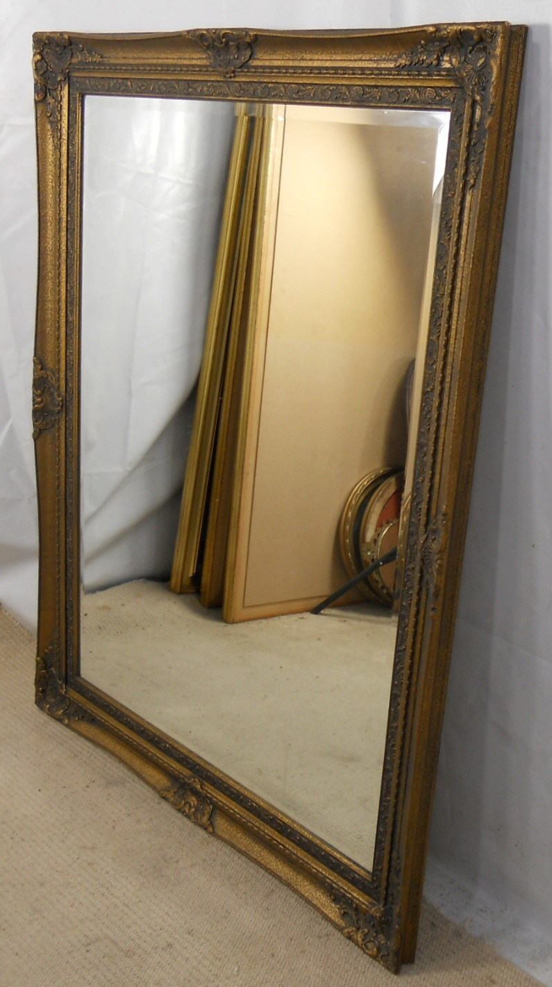large dark gilt framed