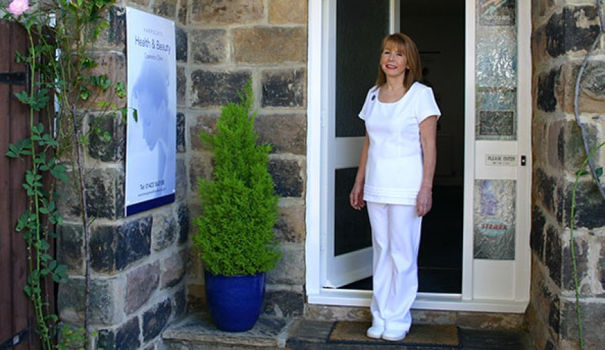 Photo of Bente at the entrance of Harrogate Beauty Clinic.