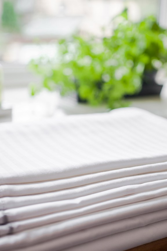 White bed linen ironed.