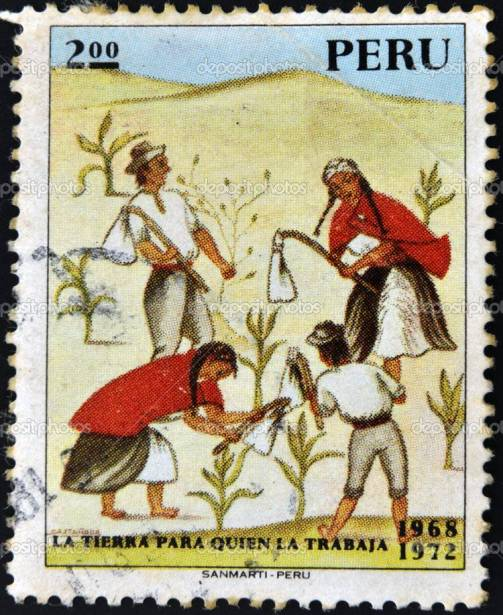 PERU - CIRCA 1972: A stamp printed in Peru shows Indians working the land with the message: the land to the tiller, circa 1972