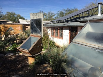 Figure 14. Solar oven, solar water heaters, and solar panels at main house