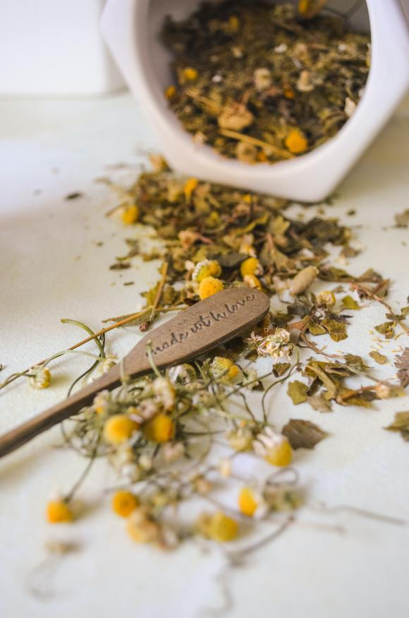 chamomile flowers on a table for a digestive tea recipe