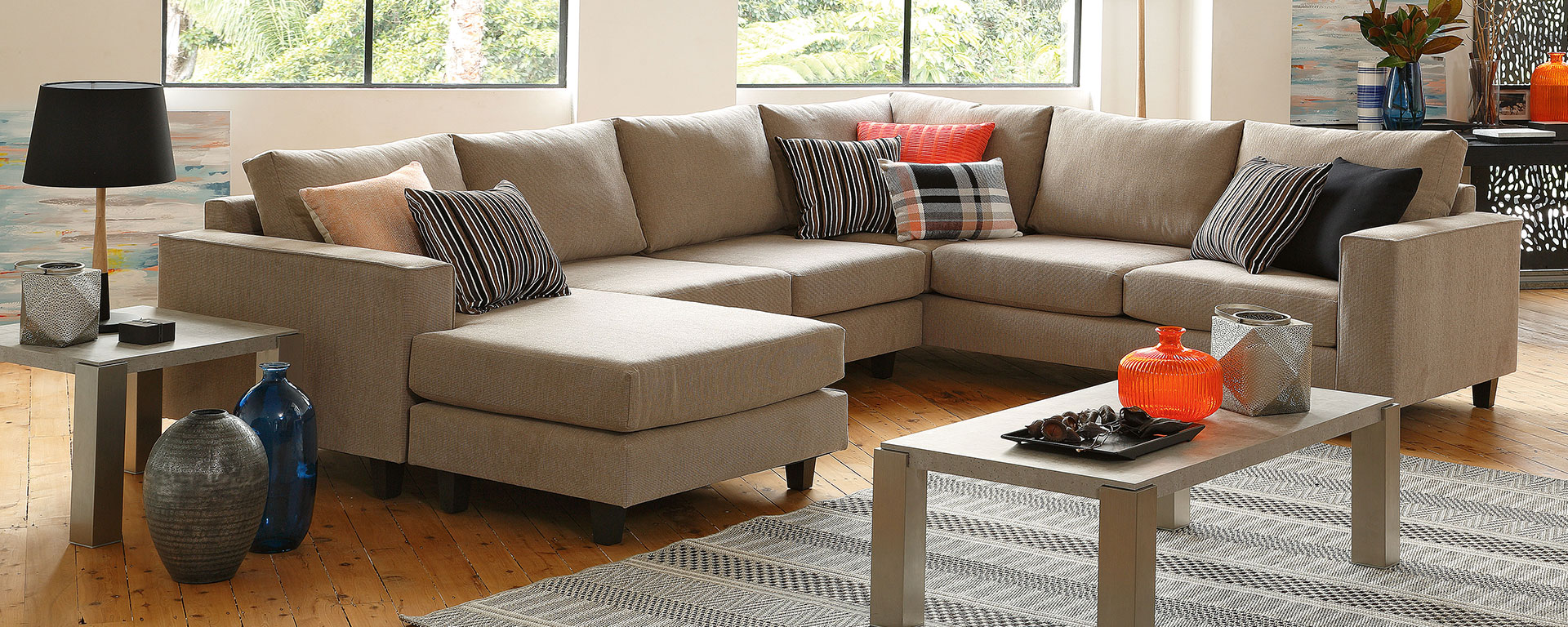 casual elegant living room furniture alessandro leather sectional collection casually modulars to transform your harvey