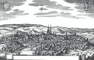 Bild: Eisleben auf einem Kupferstich von Merian aus dem 16. Jahrhundert. Das Schloss ist in der Mitte des Bildes zu sehen. Dieses Bild ist gemeinfrei, weil seine urheberrechtliche Schutzfrist abgelaufen ist.