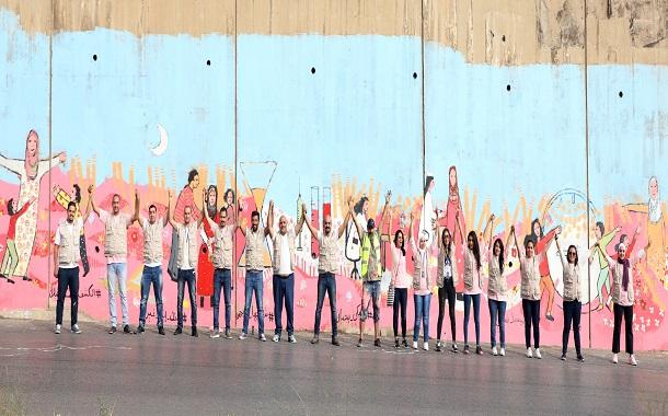 بنك الإسكان يشارك في رسم جدارية للتوعية بمرض سرطان الثدي