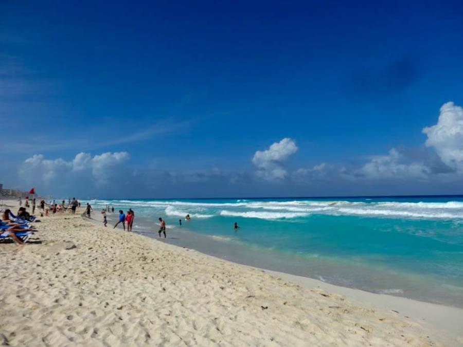 Cancún beach on the peninsula Yucatan in Mexico. The stretched white sand beaches are iconic for this coast town in Mexico.