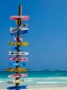 Playa Paraíso in Tulum, Mexico has its own beach crossroad direction sign