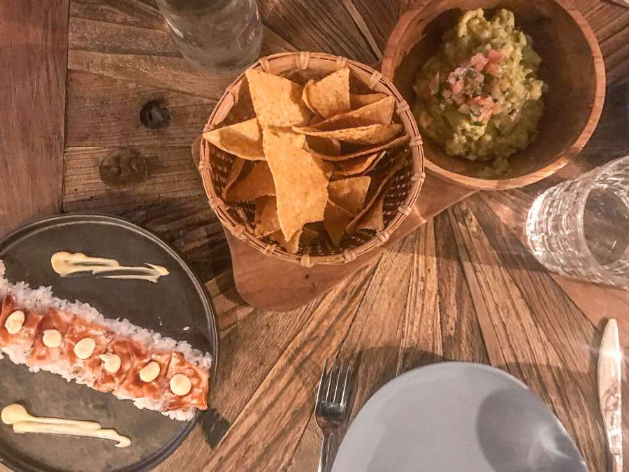 Guacamole with nachos and salmon sashimi at Voltereta