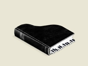 Un libro negro con forma de piano y marcadores de página imitando las teclas.