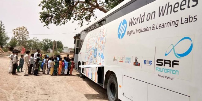 "Students ready to board ""HP World on Wheels"" (WoW), buses that are already driving digital literacy in rural India."
