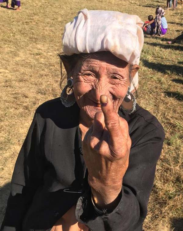 Kanhmun: An elderly woman shows her inked finger after casting her vote for the Mizoram Assembly elections in Kanhmun, Mizoram on Nov 28, 2018. (Photo: IANS)