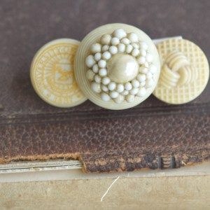Found Vintage Cream Buttons set on a Clay backing with a Pin back.$46. (Includes Shipping:)