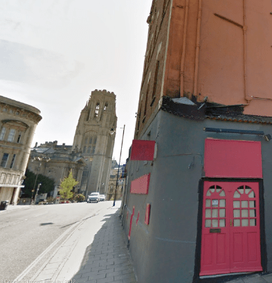 The red doors lead to what used to be the Triangle Club. The proximity of the University tower is still clearly  visible.