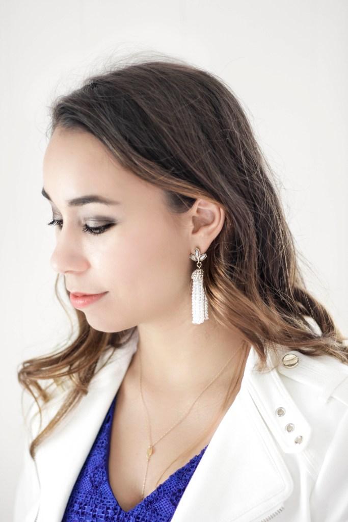 blue lace dress & winter white moto jacket with tassel earrings