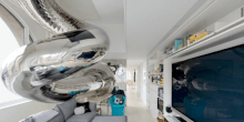 Manhattan Penthouse Features 40-Foot-Tall Mirrored Tube Slide