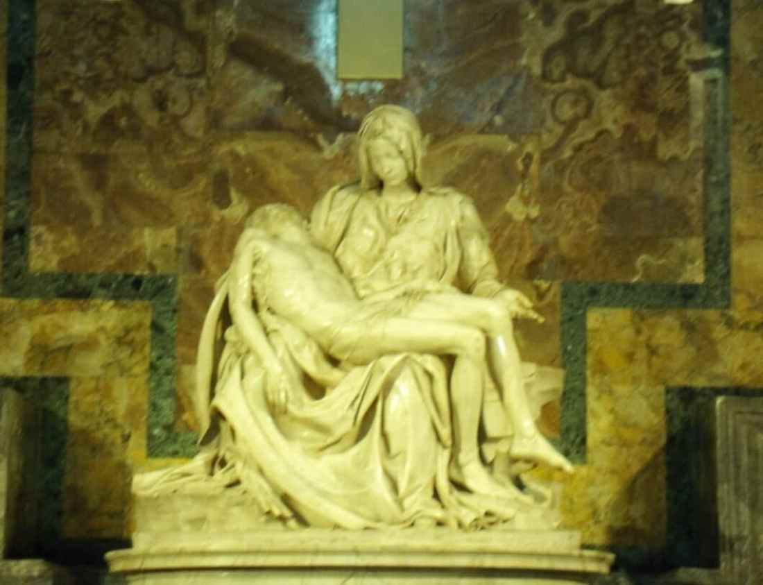 The Pietà by Michelangelo. It depicts the body of Jesus on the lap of his mother Mary after the Crucifixion.