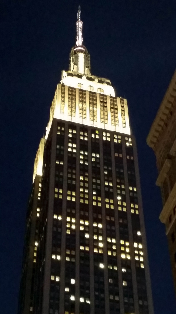 The top of The Empire State Building at night.